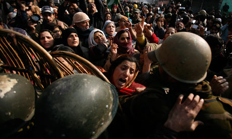 Kashmiri women confront Indian soliders during a protest over the killing of a student in Srinagar. Photograph: Farooq Khan/EPA