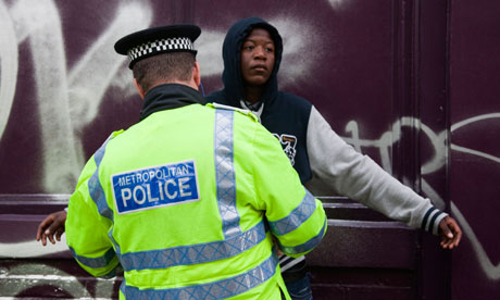 A young black man is stopped and searched by a Metropolitan police officer in London.