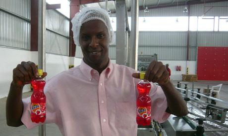 Moustapha Osman Guelleh holds strawberry drinks at the Coca-Cola bottling plant north of the Somaliland capital, Hargeisa. Photograph: Mark Tran for the Guardian