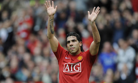Carlos Tevez waves goodbye to United fans