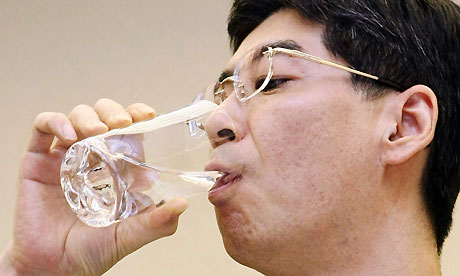 Yasuhiro Sonoda drinks a glass of decontaminated water taken from puddles inside the buildings housing reactors 5 and 6 at the Fukushima Daiichi plant. Photograph: Jiji Press/AFP/Getty Images