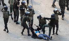 Thumbnail for Image of unknown woman beaten by Egypt's military echoes around world