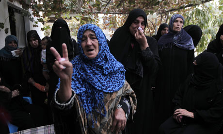A Palestinian woman makes the victory sign during the funeral of a child killed in an Israeli attack in Gaza last week.  Photograph: Said Khatib/AFP/Getty Images