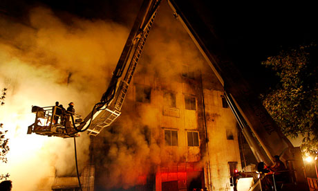 Firefighters battle the blaze at the Tazreen Fashions plant in Dhaka, Bangladesh. Photograph: Hasan Raza/AP