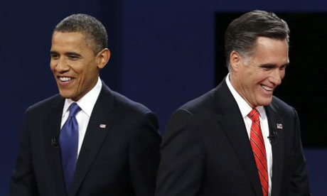 President Barack Obama walks past Republican presidential nominee Mitt Romney during the first presidential debate. Photograph: AP