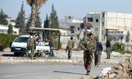 Syrian soldiers guarding the streets of Homs earlier this month. Photograph: Yin Bogu/Xinhua Press/Corbis