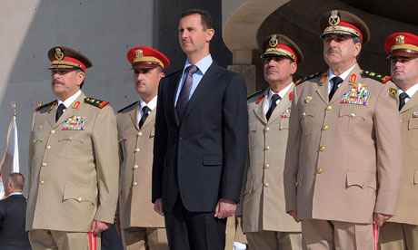 Bashar Assad and Syrian generals at a ceremony to mark the 38th anniversary of the October 1973 Arab-Israeli war. Photograph: Ho/AP