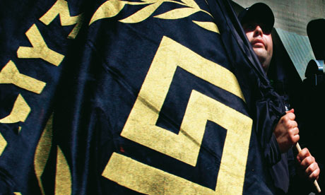 The flag of Golden Dawn: '#7;We want all illegal foreigners out of our country, we want the usurers of thetroika andthe IMF out for ever.' Photograph: Reuters