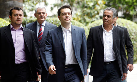 Syriza, led by Alexis Tsipras, centre, 'stands every chance of … forming a coalition government of anti-bailout forces' in Greece. Photograph: Simela Pantzartzi/EPA