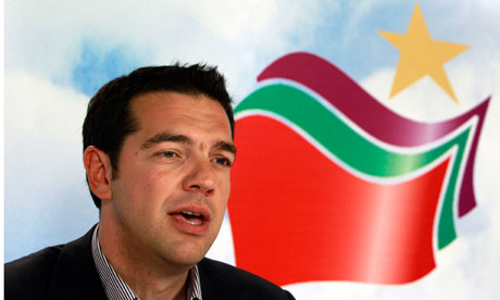 Alexis Tsipras speaks at the headquarters of his Syriza party. Photograph: John Kolesidis/REUTERS