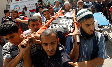 The funeral of Ghaleb Armilat, who was killed in an Israeli airstrike, takes place in Gaza. Photograph: Ibraheem Abu Mustafa/Reuters