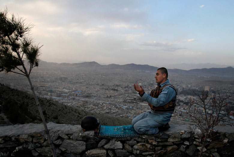 Evening prayers in Kabul, Afghanistan - picture of the day