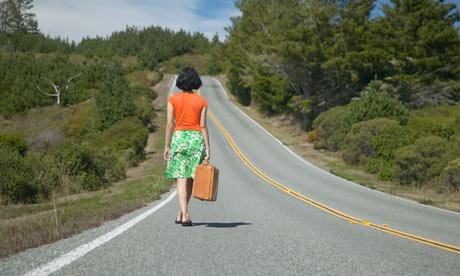Woman Walking Down Road