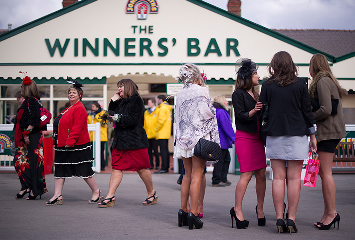 Ladies Day at the Grand National Meeting, Aintree, Liverpool - in pictures