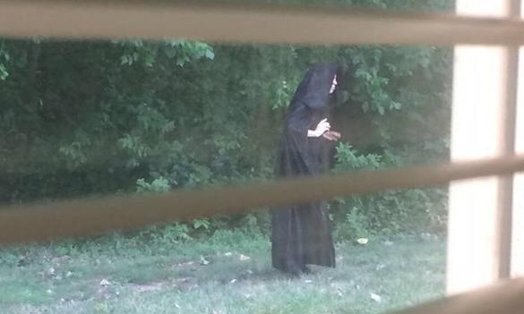 Images of cloaked figure who