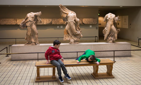 Children play near the British Museum's Parthenon marbles.  Photograph: Richard Baker/Corbis