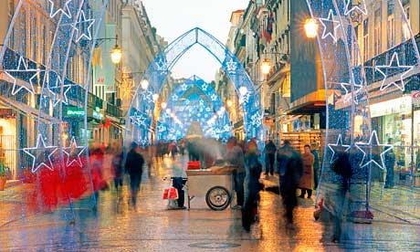 Christmas shopping on Rua Augusta, Lisbon. Photograph: Alamy